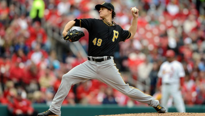 Pittsburgh Pirates starting pitcher Jeff Locke throws to a St. Louis Cardinals batter during the second inning at Busch Stadium.