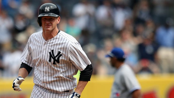 Lyle Overbay rounds the bases after slugging his go-ahead two-run homer Sunda.