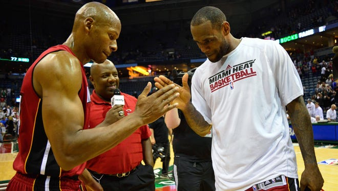 Miami Heat forward LeBron James celebrates with guard Ray Allen after beating the Milwaukee Bucks 88-77 in Game 4 of the first round at the BMO Harris Bradley Center.