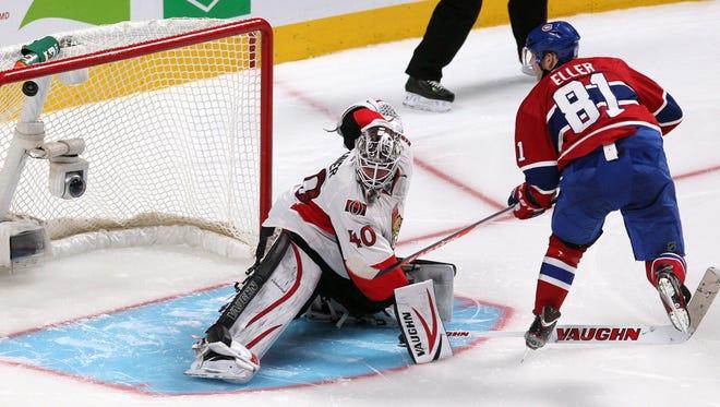 Montreal Canadiens center Lars Eller (81) scores the wining goal against Ottawa Senators goalie Robin Lehner (40) during a shootout at the Bell Centre.