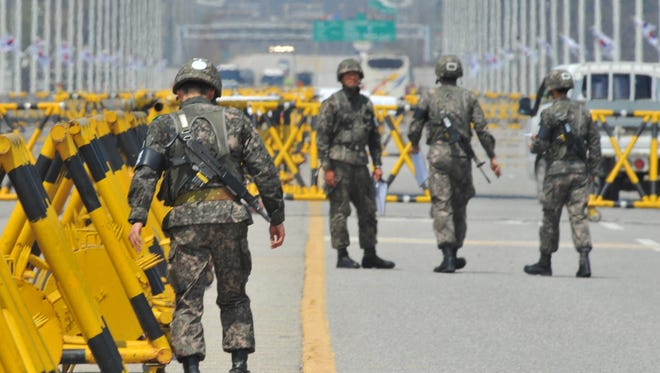 South Korean soldiers stand on the road leading to North Korea's Kaesong industrial complex, at a military checkpoint in the border city of Paju.