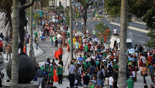 Football fans queue outside the Mario Filho --Maracana-- stadium to attend a test event, in Rio de Janeiro on April 27, 2013. The Maracana will host the upcomig Confederations Cup --next June--, the Brazil 2014 FIFA World Cup and the 2016 Summer Olympics.