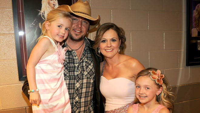 Jason Aldean with his wife,  Jessica, and their two daughters in Las Vegas during the 2012 ACM Awards show.