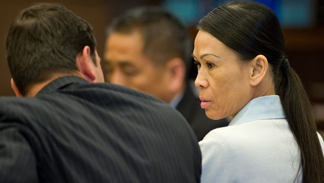 Catherine Kieu sits next to her attorney Frank Bittar April 17, 2013, in Santa Ana, Calif. She was convicted April 29 of severing her husband's penis.
