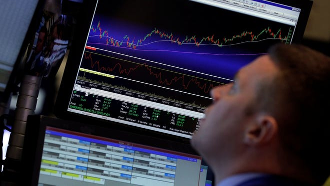 Specialist Frank Masiello works at his post on the floor of the New York Stock Exchange on April 29, 2013.