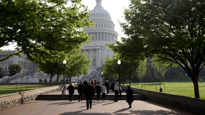 People walk to the Capitol on Capitol Hill, Wednesday, April 24, 2013, in Washington.
