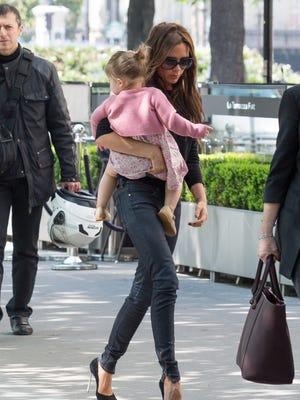 Victoria Beckham and her daughter, Harper Seven Beckham,  arrive at the Matignon  restaurant on April 21 in Paris.