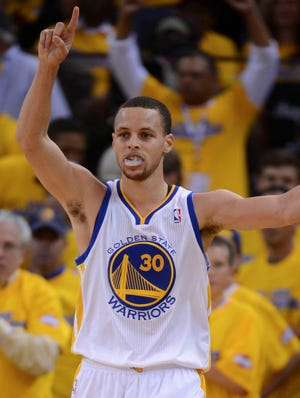 Warriors point guard Stephen Curry raises one finger in celebration during Game 4 vs. the Nuggets.