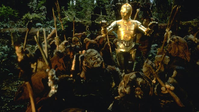 "C-3PO is deemed a deity by the Ewoks in a scene from ""Return of the Jedi."""
