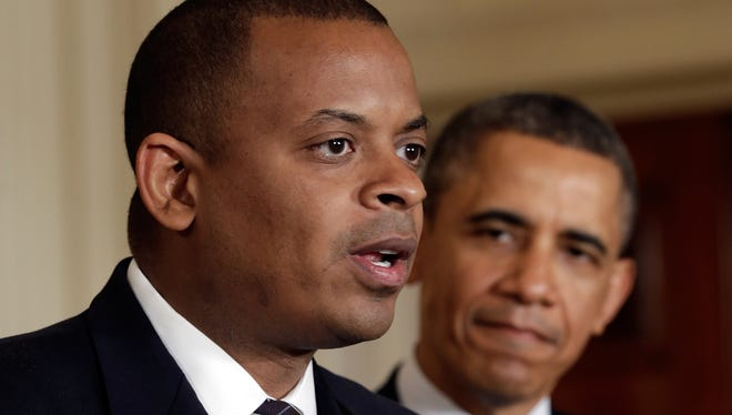 U.S. President Barack Obama (right) listens as Charlotte Mayor Anthony Foxx speaks after he was announced as Obama's nominee for Secretary of Transportation at the White House on April 29, 2013 in Washington, D.C.