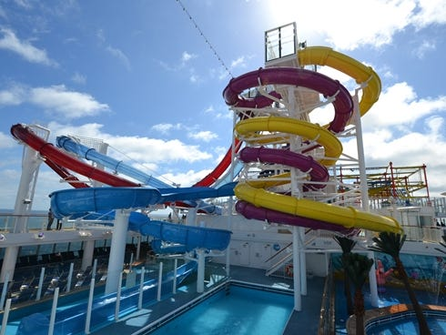 The hub of the Norwegian Breakaway's top deck areas is the Aqua Park, a family-friendly fun zone that is home to five multi-story waterslides.