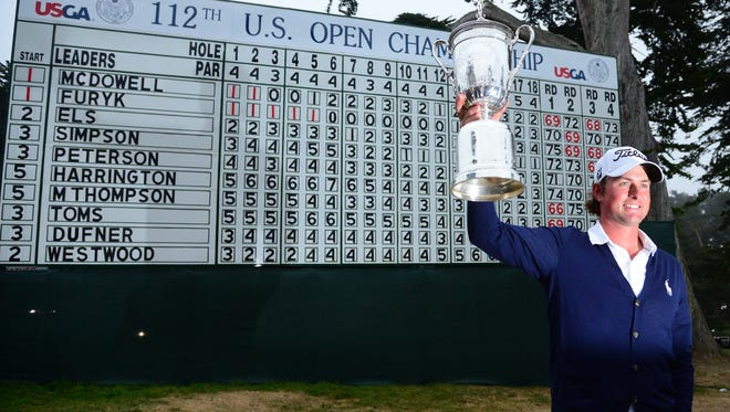 Webb Simpson hoists the trophy after winning the 2012 U.S. Open at  The Olympic Club.