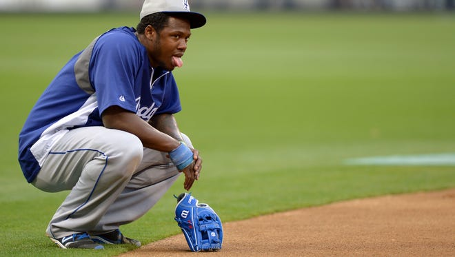 Los Angeles Dodgers shortstop Hanley Ramirez (13) reacts after taking ground balls during fielding drills.