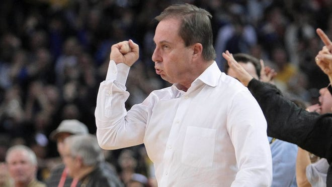 Golden State Warriors owner Joe Lacob celebrates from his court side seat in a recent game.