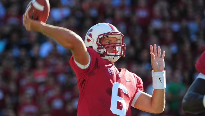 Stanford quarterback Josh Nunes (6) passes the ball during the first quarter against USC on Sept. 15, 2012. Nunes is giving up football because of an arm injury suffered this winter.
