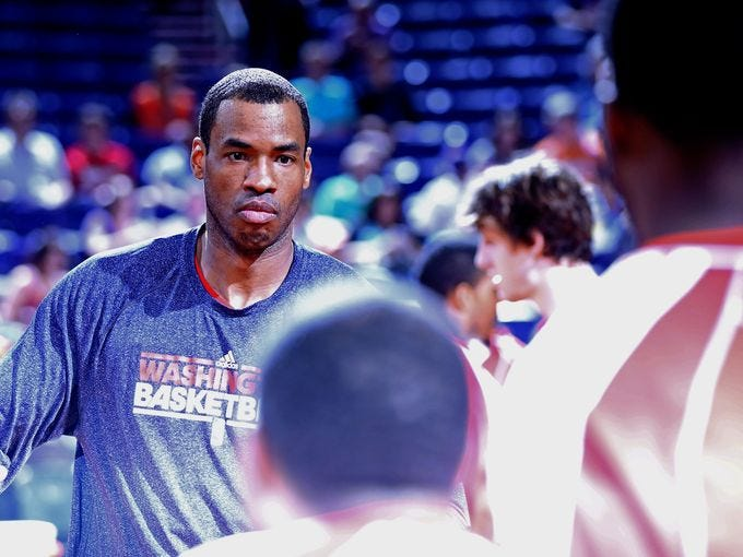 Jason Collins finished this NBA season with the Wizards, then announced Monday he is gay, the first openly gay player in the NBA. Flip through this gallery for a look at his career.