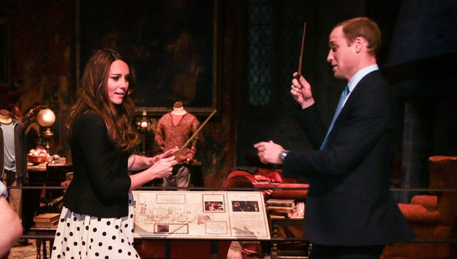 Expectant parents Prince William and Duchess Kate practice their magic wand style on visit to  studio where the Harry Potter movies were made.