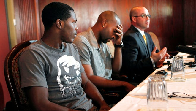 Darius McClinton-Hunter, left, and Torii Hunter attend a news conference in May 2012 to deny allegations that McClinton-Hunter sexual assaulted a classmate.
