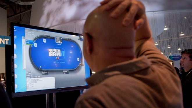 This Oct. 4, 2011 file photo shows an online poker player playing a game during industry's G2E conference, in Las Vegas.