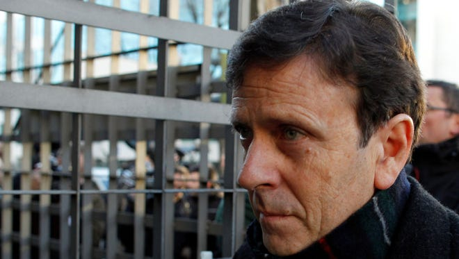 Dr. Eufemiano Fuentes arrives at a court house in Madrid in January at the heart of one of cycling's biggest doping scandals.