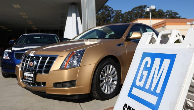 New cars sit on the sales lot of a Chevrolet dealership in Colma, Calif.