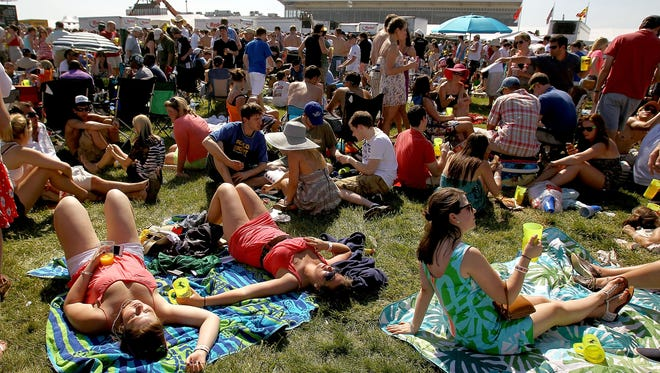 Race fans enjoy the infield during last year's Preakness Stakes at Pimlico Race Course in Baltimore. Starting this year, no backpacks and only clear coolers  will be allowed.