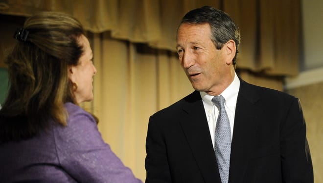 Former South Carolina governor Mark Sanford shakes hands with Democratic candidate Elizabeth Colbert Busch during the 1st Congressional District debate on Monday in Charleston, S.C.