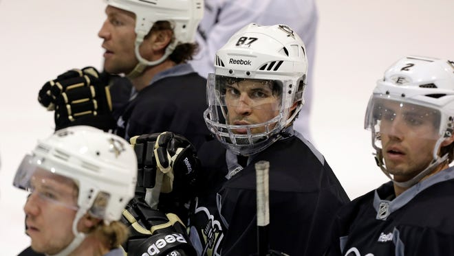 Pittsburgh Penguins center Sidney Crosby has a full shield on during Tuesday's practice.