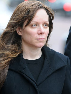 Dina Wein Reis leaves the Federal Court Building in Indianapolis on Wednesday, Nov. 6, 2008. Reis was sentenced Tuesday, April 30, 2013, to 19 months in prison on a charge of conspiracy to commit wire fraud.