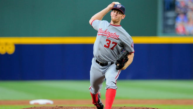 Washington Nationals starting pitcher Stephen Strasburg (37) pitches against the Atlanta Braves during the first inning at Turner Field.