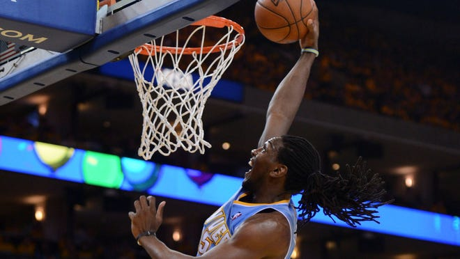 Denver Nuggets small forward Kenneth Faried (35) dunks against Golden State Warriors center Andrew Bogut (12), one of the few bright spots for the Nuggets, who are down 3-1 in the series.