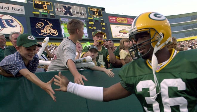 Former Green Bay Packers safety LeRoy Butler, here greeting fans at a game in July 2000 at Lambeau Field, has gotten an unwelcome greeting from a church that had invited him to speak.