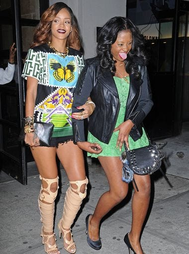 Rihanna, left, is on the move with a companion on April 30 in New York.