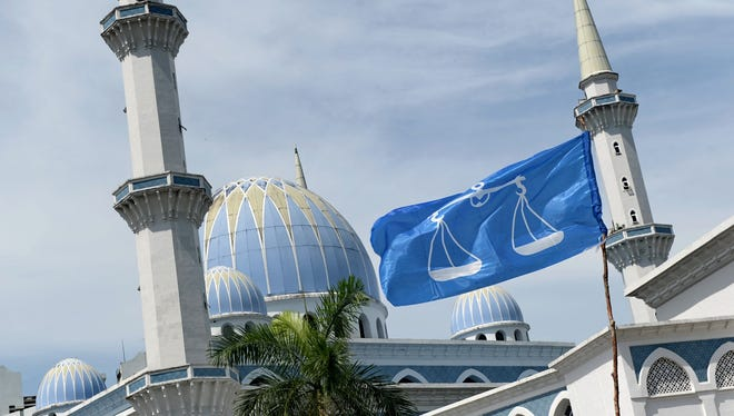 The Barisan National party flag flies next to the Sultan Ahmad Shah State Mosque on April 19 in Malaysia.