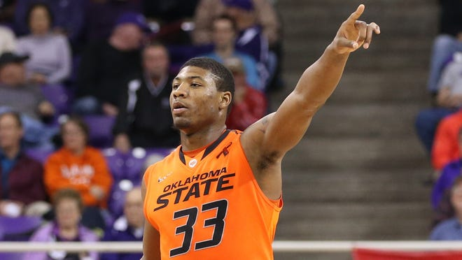 Oklahoma State guard Marcus Smart was a projected NBA lottery pick, but his return to the Cowboys for his sophomore season gives them a great chance to snap Kansas' Big 12 championship streak in 2013-14.