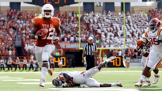 Texas running back Johnathan Gray (32) runs the ball for a touchdown against Iowa State in at Darrell K Royal-Texas Memorial Stadium. The Longhorns athletic department has the largest budget of any in the nation, leading the nation in revenue and expenditures.