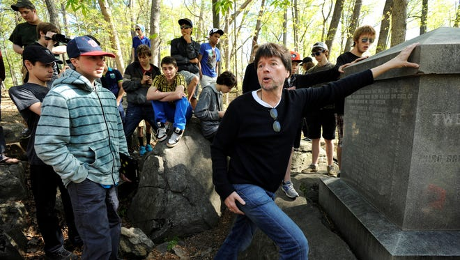 Filmmaker Ken Burns tells the story of Chamberlain's defense of Little Round Top to students from The Greenwood School at the 20th Maine Monument at Gettysburg National Military Park.
