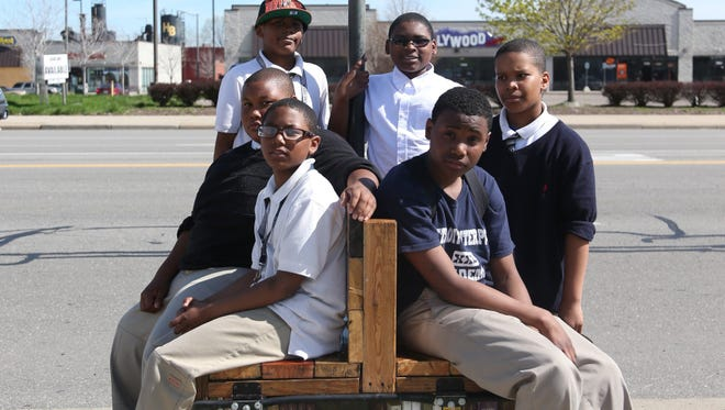 Students from Detroit Enterprise Academy Jonathan Cobb 12, Dajuan Lawrence, Joseph Cobb 12, Jonathan Rush 12, Da Ron Todd 11 and Kenyatta Sellers helped build this bus stop bench complete with a book shelf in Detroit.