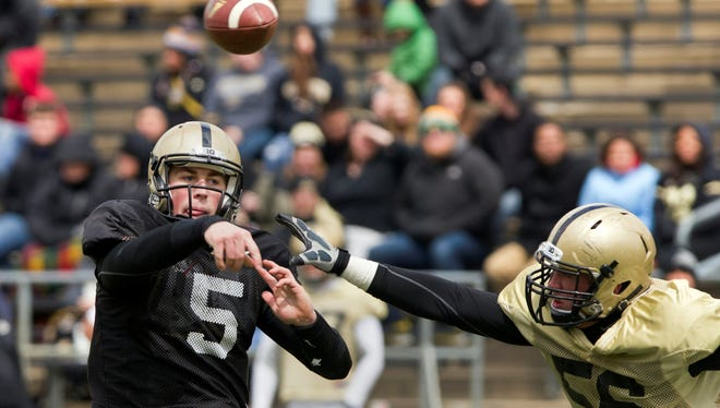 Danny Etling was 5-for-7 for 54 yards and an interception at Purdue's spring game. He graduated from high school in Terre Haute, Ind., early in order to enroll at Purdue in time to take part in spring practice.
