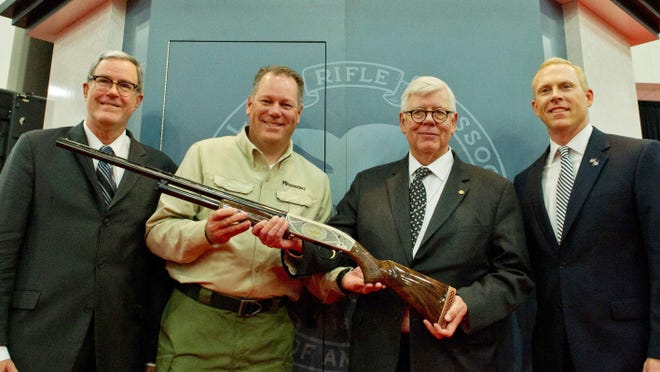 NRA (National Rifle Association) President David Keene(2nd-R) is presented with a Mossberg shotgun at the (NRA) Annual Convention on May 4, 2013 in Houston, Texas.
