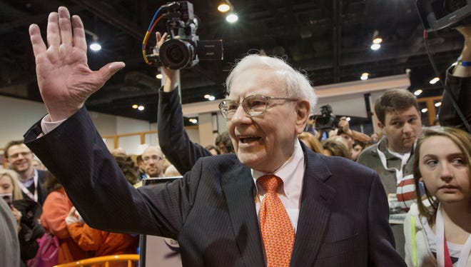 Investor Warren Buffett greets shareholders on May 4, while touring the exhibit floor prior to the Berkshire Hathaway shareholders meeting in Omaha, Neb.