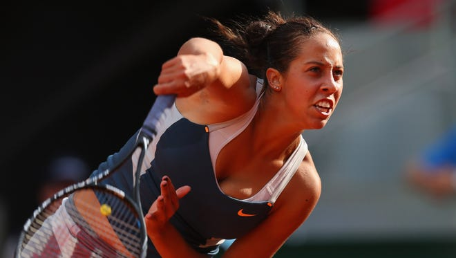 Madison Keys of the USA serves up a victory against Li Na of China.