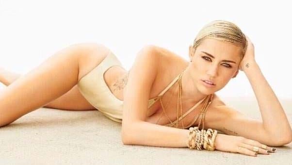Miley Cyrus says she tops the new 'Maxim' Hot 100 list for 2013.