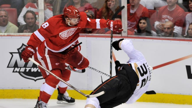 Detroit Red Wings left wing Justin Abdelkader (8) checks Anaheim Ducks defenseman Toni Lydman (32) during the second period of Saturday's Game 3 of the NHL first-round series. Lydman left the game and did not return.