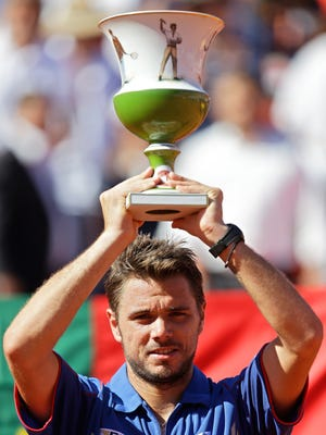 Stanislas Wawrinka of Switzerland hoists the trophy after winning the Portugal Open.