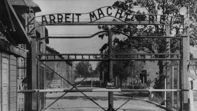 "An undated photograph of the main gate of the Nazi concentration camp Auschwitz in Poland. The sign over the gate reads: ""Arbeit macht frei"" (Work Sets You Free)."