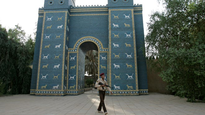 An Iraqi armed soldier walks in front of Ishtar Gate of ancient Babylon about 50 miles south of Baghdad, Iraq, Sept. 18, 2008. Babylon was once among the greatest cities in the world.