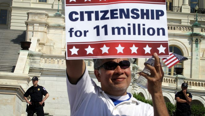 An immigration activist demonstrates at the U.S. Capitol last month.