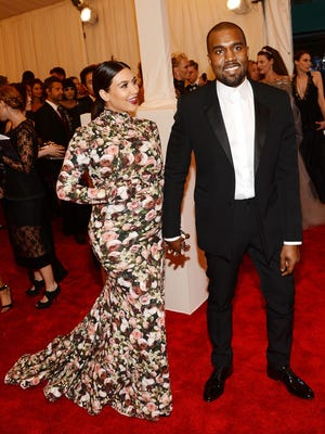 Kim Kardashian and Kanye West attend the Costume Institute Gala for the PUNK: Chaos to Couture exhibition at the Metropolitan Museum of Art on Monday.