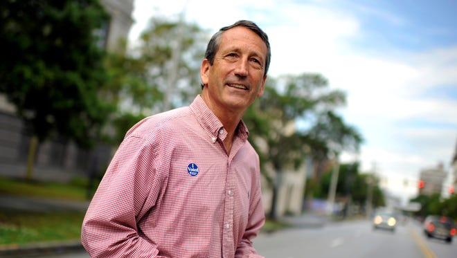 Republican Mark Sanford crosses the street after voting in a special election for Congress in South Carolina.